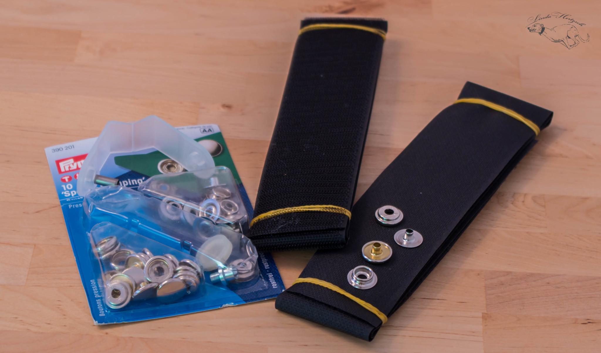 Druckknöpfe inklusive Werkzeug zum Anbringen (kein Nähen nötig) und das Klettband.